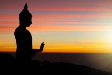Silhouette Of Buddha Statue On Sunrise Background