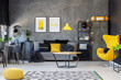 Grey and yellow scandinavian living room with stylish egg chair, modern coffee table and comfortable couch with pillows