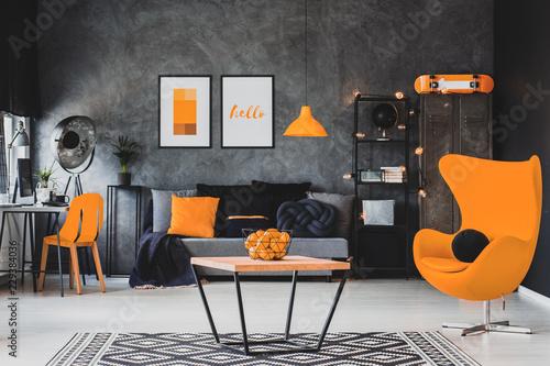 Grey and orange scandinavian living room interior with ...