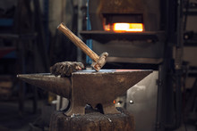 Mallet And Gloves On An Anvil ...