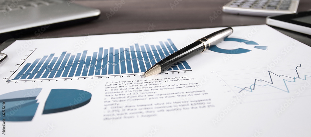 Fototapeta business background. financial report on the table at the businessman