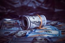 In The Dark On Broken Money Is A Roll Of Dollars.