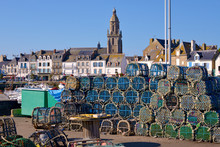 Stack Of Lobster Pot And Notre-Dame-de-Pitié Church At Le Croisic, A Commune In The Loire-Atlantique Department In Western France