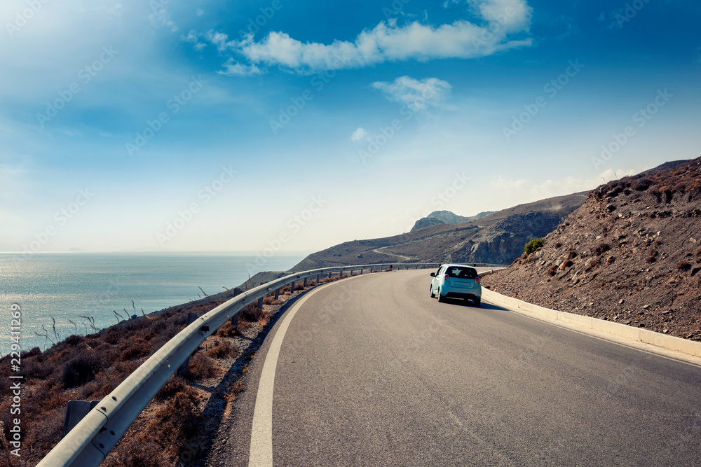 Fototapety, obrazy: Blue small car rides along a serpentine mountain road along the sea, Kos island, Greece