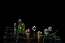 Spa Concept, Wellness, Relaxation, Lighted Candles, Hot Stones, On Black Background Spa Treatment