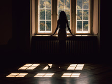 Young Woman Silhouette, Looking Through The Window, Strong Shadows