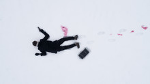 Dead Man On Snow With Gun And Case Of Cash. View From Above.