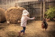 Child Farmer Playing Fun In Fa...