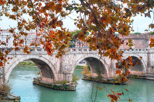 Roman stone arch bridge over the Tiber River. Bridge opposite the castle of the holy angel. Rome, Italy