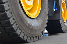 The Protector Of A Large Rubber Wheel. Huge Rubber Tire Career Dump Trucks, Mining Trucks From The Tipper. Mounting