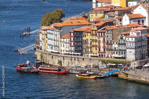 Fototapeta Traditional boats with barrels of wine, on the Douro River in the Portuguese city of Porto. obraz na płótnie