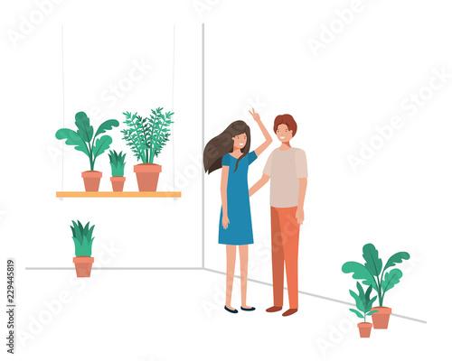 Fototapeta young couple with house plant avatar character obraz na płótnie