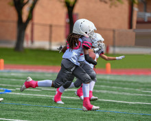 Little Boys And Girls Playing Youth Tackle Football