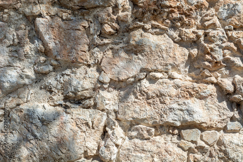 Poster Stenen Bright stone wall texture background closeup, fragment from fort in Alanya, Turkey