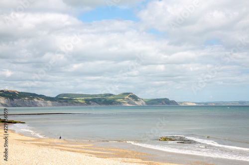 Tuinposter Strand Person walking on the beach in England