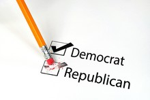 Close Up Of Yellow Pencil Erasing Voting Choice On Election Ballot From Republican To Democrat