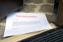 EVICTION NOTICE SLIPPED UNDER OPENED ENTRANCE DOOR