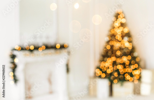 Leinwand Poster Holiday decorated room with Christmas tree and decoration, backgroound with blurred, sparking, glowing light