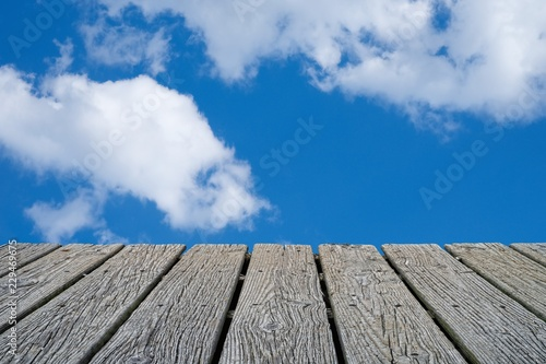 Fotografie, Obraz  EMPTY WOOD DECK WITH BLUE SKY AND WHITE CLOUD