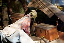 Skeleton Mechanic Working On An Old Truk