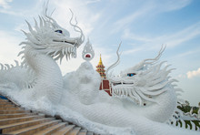 The Beautiful Twin Chinese Dragon Sculpture Of Wat Huay Pla Kung Temple In Chiang Rai Province Of Thailand.