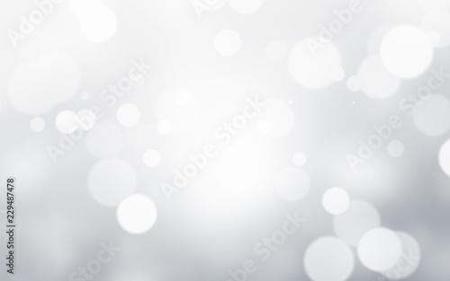 Fotografiet  Silver light background with blur bokeh