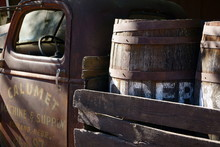 Rusty Old Truck With A Load Of Wood Whisky Barrels
