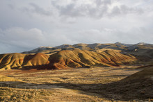 Painted Hills, Oregon. As One Of The Three Units Of The John Day Fossil Beds, This Area Preserves A Sequence Of Past Climate Change, Distinguished By Varied Stripes Of Red, Tan, Orange, And Black.