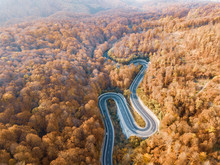 Winding Road From High Mountain Pass, In Autumn Season.