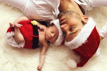 Handsome Father Next To His Newborn In Santa Hat . Christmas Concept