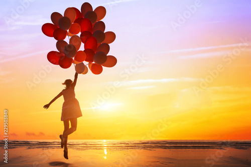 Photo  happiness or dream concept, silhouette of happy woman jumping with multicolored