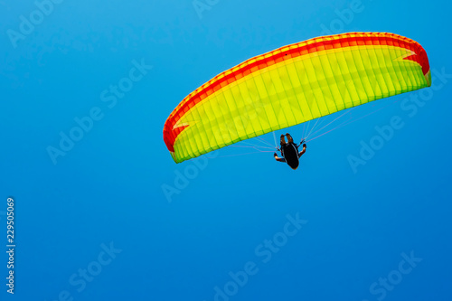Parachutist on the background of blue sky.