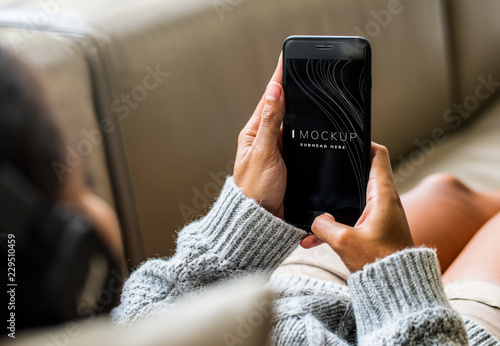Woman using a mobile phone mockup