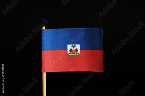 Photo A official Flag of Haiti on toothpick on black background