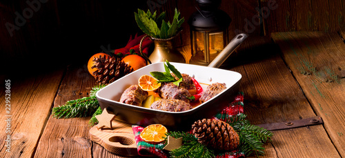 Fotografie, Obraz  Wintry beef roulades with plum and bacon stuffing and cucumber