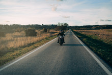 Biker Riding A Motorcycle On The Road