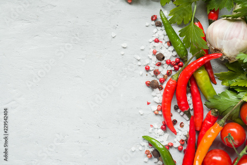 Photo sur Toile Hot chili Peppers Hot chili peppers multi-colored, tomato cherry on branch, garlic