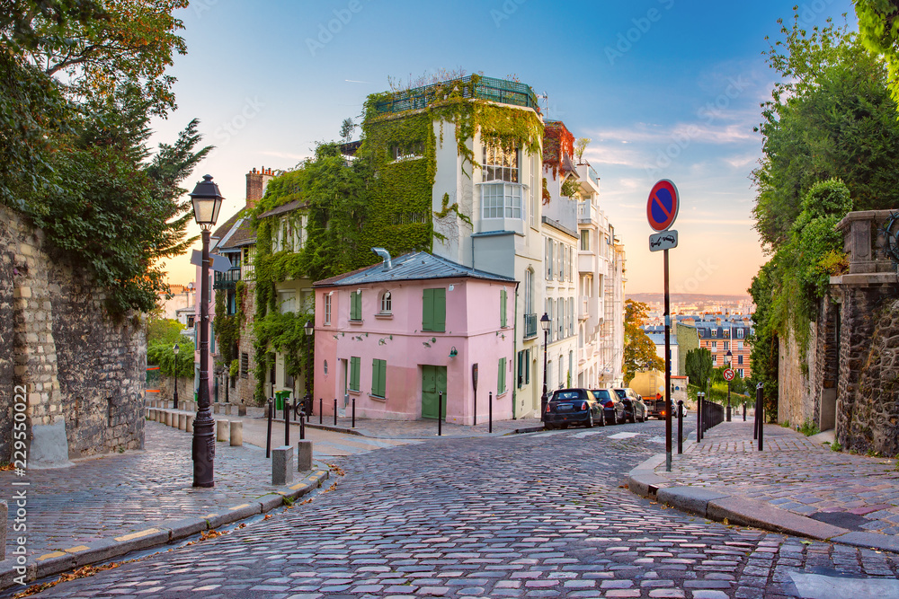 Fototapeta Cozy old street with pink house at the sunny sunrise, quarter Montmartre in Paris, France