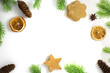 Christmas composition. Christmas frame of fir branches cinnamon, orange and star anise. Christmas Wallpaper. Flat position, top view