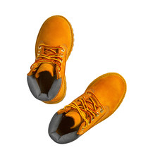 Brown Or Yellow Boots Shoes For Foot And Adventure Travel Or Keep Walking Journey With Trekking On Floor Or Ground And Top View Isolated On White Included Clipping Path