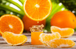 Orange Essential Oil on green leaves background