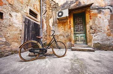 Fototapeta Old retro bicycle on vintage street in Croatia background aged