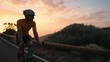Man bicyclist in yellow t-shirt rides a mountain bike at sunset on the highway