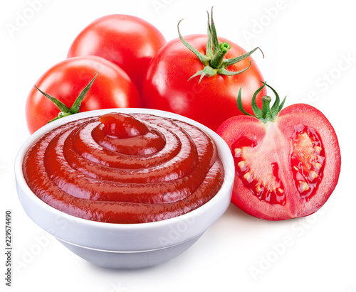 Keuken foto achterwand Kruiderij Bowl of ketchup sauce and and red ripe tomatoes on white background.