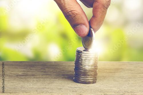 Fotografía  Hand picking up coins