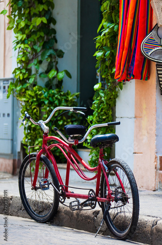 Fotobehang Zuid-Amerika land Bicycle parked at the beautiful streets of the walled city in Cartagena de Indias