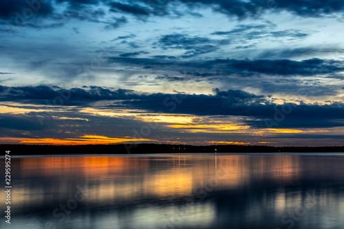 Fényképezés  Sunset over a lake.