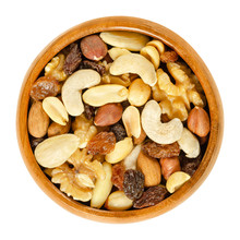 Student Food In Wooden Bowl. Student Fodder. Snack Mix Of Dried Almonds, Cashews, Peanuts, Walnuts, Hazelnuts And Raisins. Trail Mix. Isolated Macro Food Photo Closeup From Above On White Background.