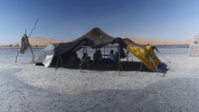 Men Relaxing In The Shadow Of A Tent, Drinking Tea In Merzouga Desert Morocco