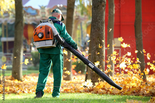 Working in the Park removes leaves with a blower Canvas Print